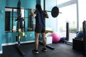 Women squat barbell gym