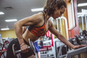Women dumbbell single arm bent- over row