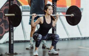 women sumo squat spotter inner thigh