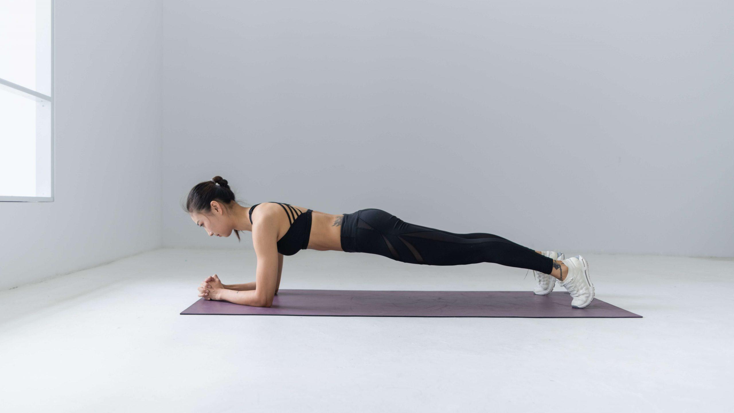 white background plank woman