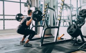 man barbell back squat weights