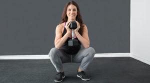 Women goblet squat dumbbell